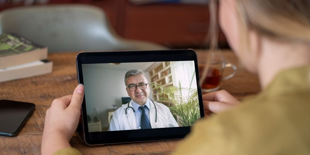 concierge doctor providing care over tablet