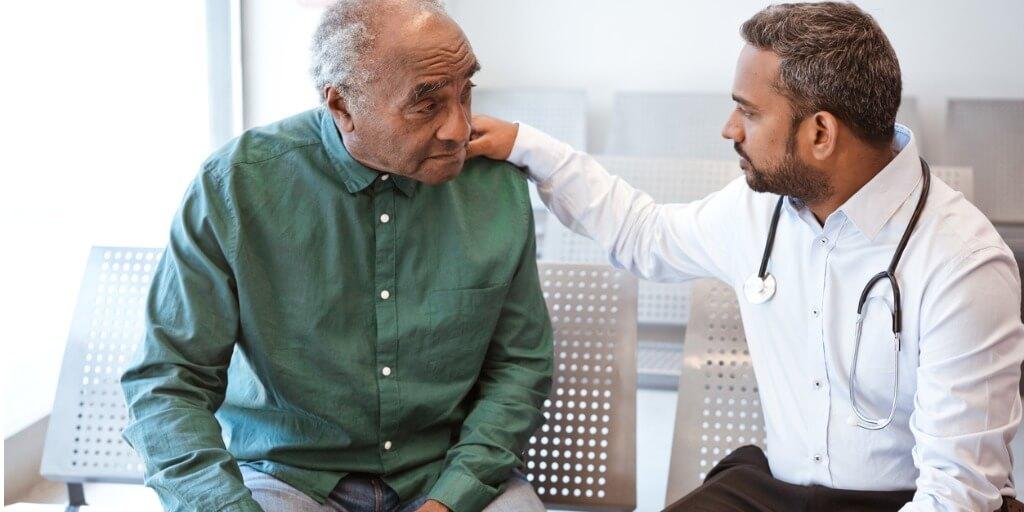 elderly male patient seeing doctor