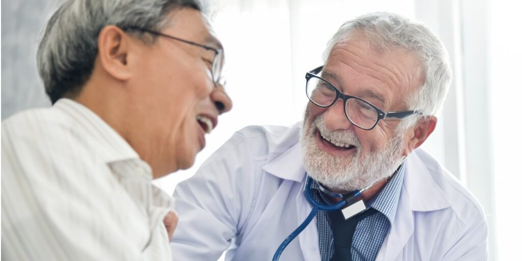 male concierge doctor laughing with patient
