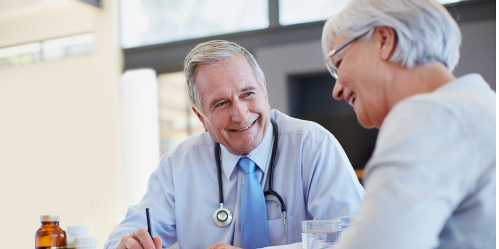 male concierge doctor speaking with patient