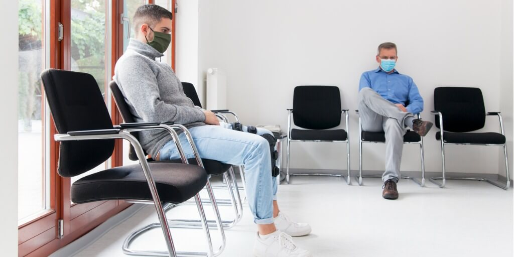 two men in a waiting room at the doctor's office
