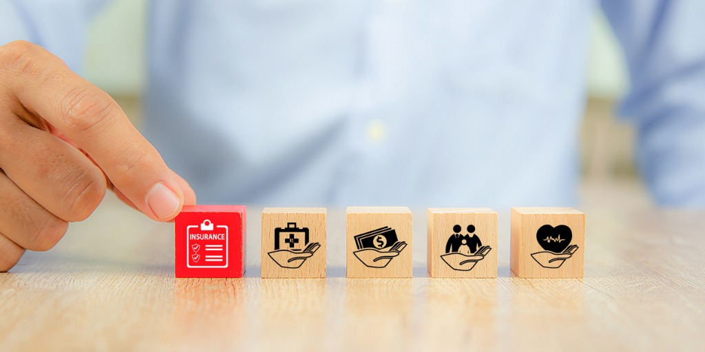 closeup-hand-choose-a-red-wooden-toy-blocks-with-family-icon-for-picture-id1198967518