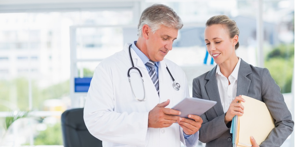 confident-doctor-and-pretty-businesswoman-discussing-picture-id845758122