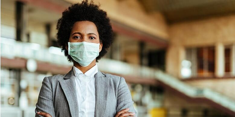 young business executive with mask