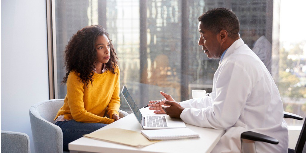 A woman meets with her doctor to discuss if she is right for genetic testing.