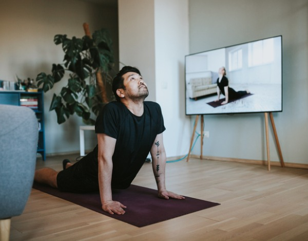 japanese-man-taking-online-yoga-lessons-during-lockdown-in-isolation-picture-id1217191817 (1)