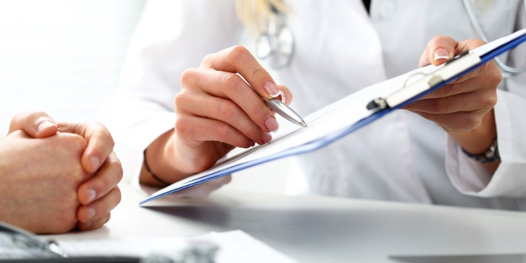 female-doctor-hand-hold-silver-pen-filling-patient-history-list-picture-id639844314