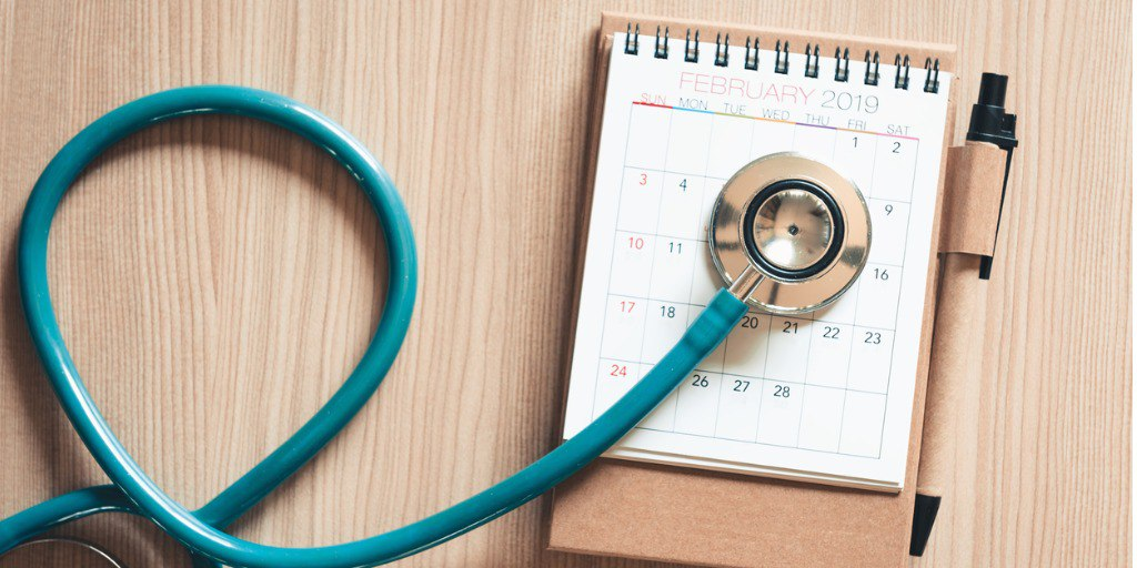 Top view of stethoscope over calendar.