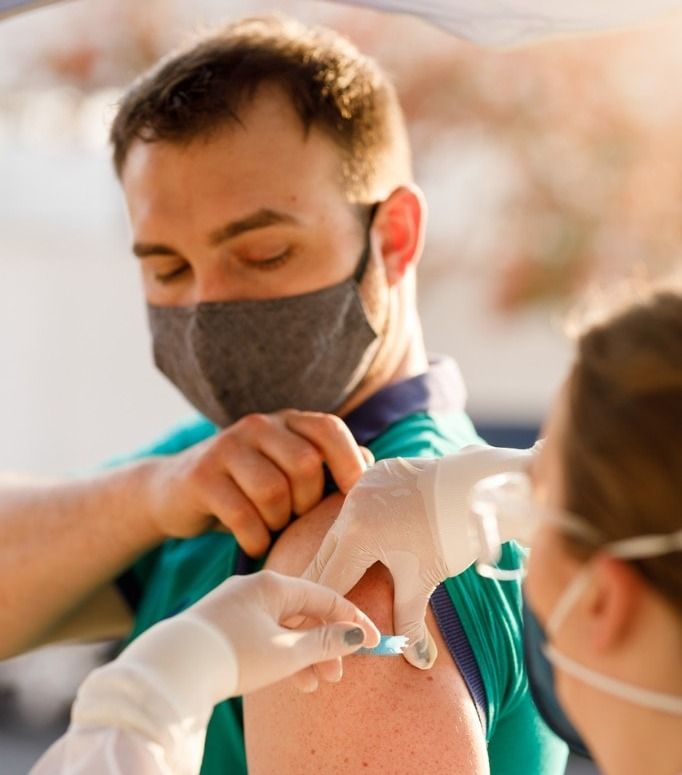 man-receiving-vaccine-for-covid19-picture-id1271756986-web