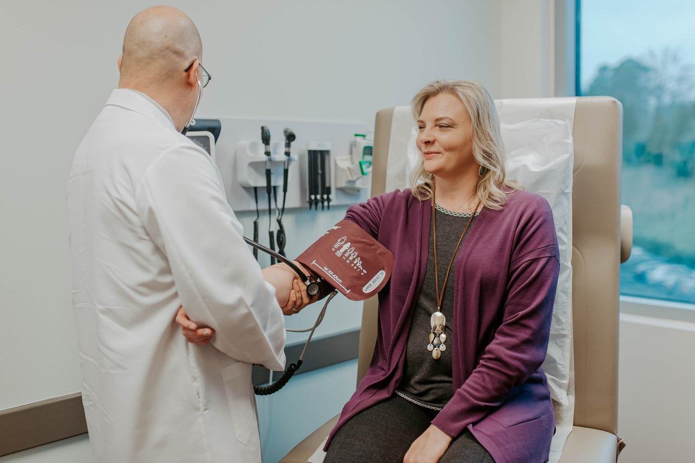 patient-with-doctor-exam-room