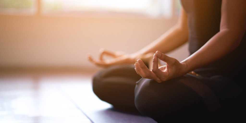 women-in-meditation-while-practicing-yoga-in-a-training-room-happy-picture-id1166417394